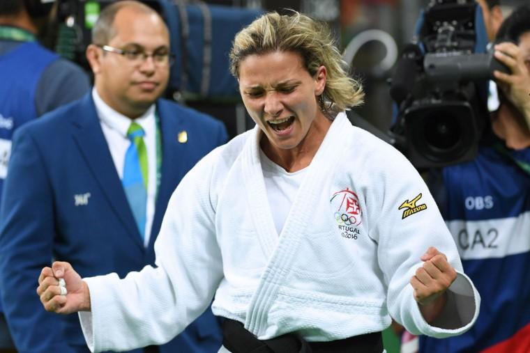 Portugal's Telma Monteiro (white) celebrates after defeating Romania's Corina Caprioriu during their women's -57kg judo contest bronze medal A match of the Rio 2016 Olympic Games in Rio de Janeiro on August 8, 2016. (TOSHIFUMI KITAMURA/AFP/Getty Images)