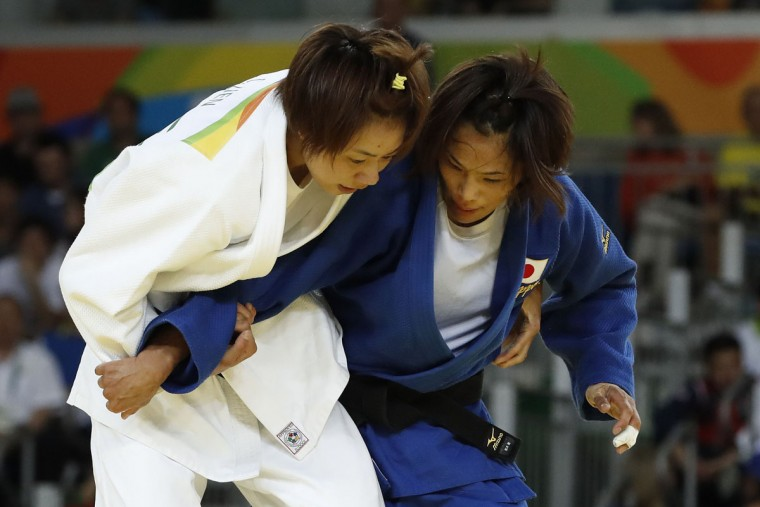 Taiwan's Lien Chen-Ling (white) competes with Japan's Kaori Matsumoto during their women's -57kg judo contest bronze medal B match of the Rio 2016 Olympic Games in Rio de Janeiro on August 8, 2016. (JACK GUEZ/AFP/Getty Images)