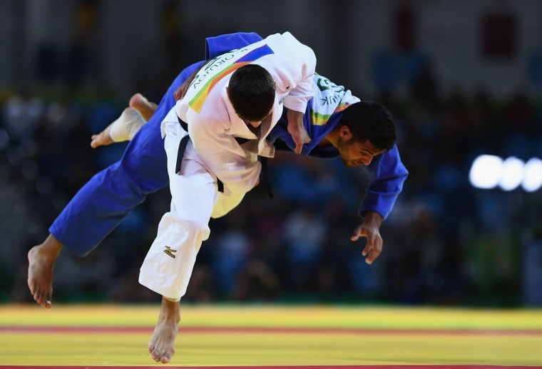 Rustam Orujov of Azerbaijan (white) competes against Sagi Muki of Israel in the Men's -73 kg Semifinal of Table B Judo match on Day 3 of the Rio 2016 Olympic Games at Carioca Arena 2 on August 8, 2016 in Rio de Janeiro, Brazil. (Photo by David Ramos/Getty Images)