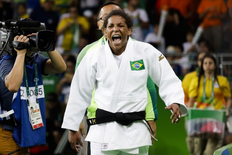 Brazil's Rafaela Silva reacts after defeating Romania's Corina Caprioriu during the semi-final of the women's 57-kg judo competition at the 2016 Summer Olympics in Rio de Janeiro, Brazil, Monday, Aug. 8, 2016. (AP Photo/Markus Schreiber)