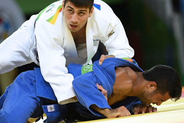 Azerbaijan's Rustam Orujov (white) competes with Israel's Sagi Muki during their men's -73kg judo contest semifinal B match of the Rio 2016 Olympic Games in Rio de Janeiro on August 8, 2016. (TOSHIFUMI KITAMURA/AFP/Getty Images)