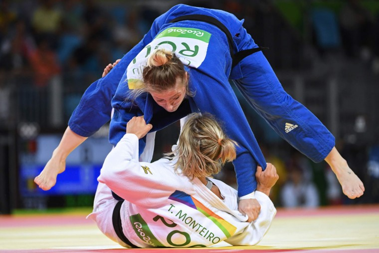 Portugal's Telma Monteiro (white) competes with Romania's Corina Caprioriu during their women's -57kg judo contest bronze medal A match of the Rio 2016 Olympic Games in Rio de Janeiro on August 8, 2016. (TOSHIFUMI KITAMURA/AFP/Getty Images)