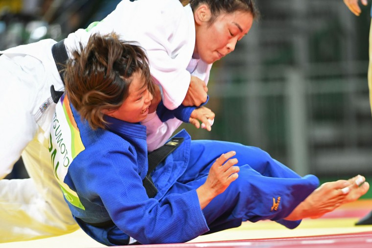 Mongolia's Sumiya Dorjsuren (white) competes with Japan's Kaori Matsumoto during their women's -57kg judo contest semifinal A match of the Rio 2016 Olympic Games in Rio de Janeiro on August 8, 2016. (TOSHIFUMI KITAMURA/AFP/Getty Images)