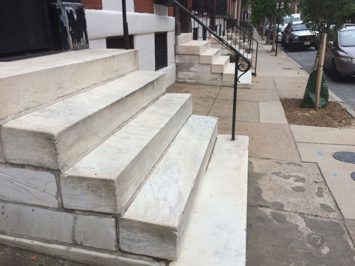 The tradition of step scrubbing has all but died out in Baltimore, as evidenced by the non-gleaming quality of steps on Calvert Street. (Christina Tkacik/Baltimore Sun)