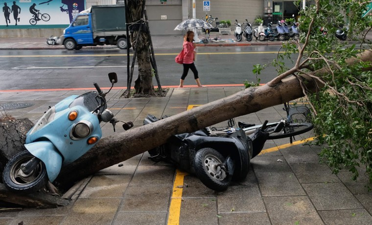 Scooters lie in the street after a tree has been uprooted by strong winds from typhoon Megi at Xindian district in New Taipei City on September 28, 2016. Typhoon Megi hit the Chinese mainland early in the morning on September 28 killing one, after leaving a trail of destruction in Taiwan, where four are dead and a million still without power. (SAM YEH/AFP/Getty Images)