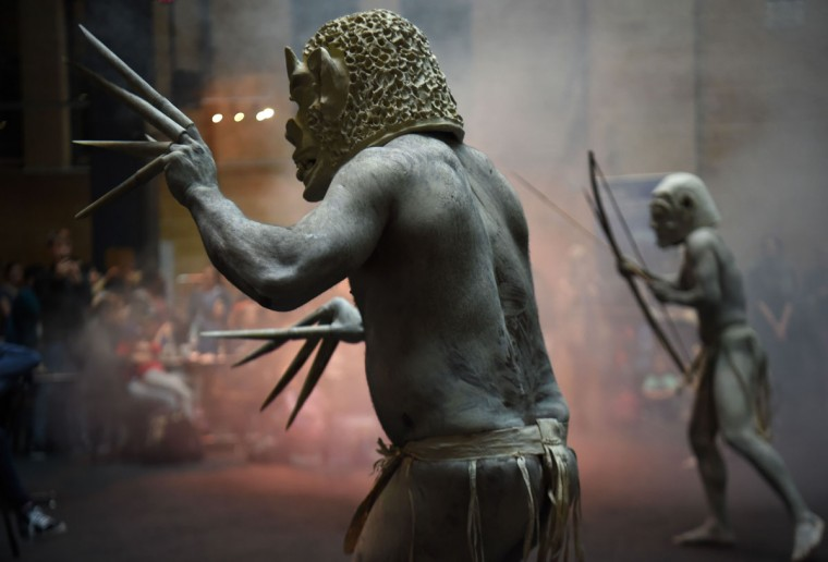 Asaro Mud Men from the Asaro Valley in Papua New Guinea's eastern highlands perform, for the first time outside their home, their rituals for visitors at the Australian Museum in Sydney on September 29, 2016. The eerie show is traditionally intended to intimidate their enemies in the highlands of Papua New Guinea with the men donning masks and white clay on their bodies and elongating their fingers with bamboo, they perform a dance with the warriors holding bows and arrows. (PETER PARKS/AFP/Getty Images)
