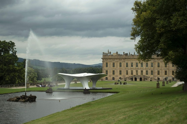 A sculpture by Iraqi-born British architect Zaha Hadid entitled 'Lilas' that features in the 'Beyond Limits' exhibition is displayed in the grounds of Chatsworth House near Bakewell, northern England, on September 9, 2016. (OLI SCARFF/AFP/Getty Images)