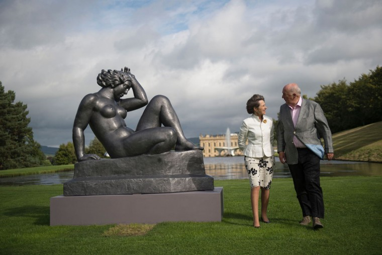 Peregrine 'Stoker' Cavendish (right), Duke of Devonshire, and his wife Amanda, Duchess of Devonshire pose with a sculpture by French artist Aristide Maillol entitled 'La Montagne' that features in the 'Beyond Limits' exhibition in the grounds of Chatsworth House near Bakewell, northern England, on September 9, 2016. (OLI SCARFF/AFP/Getty Images)