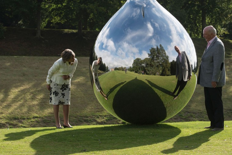 Peregrine 'Stoker' Cavendish (right), Duke of Devonshire, and his wife Amanda, Duchess of Devonshire examine a sculpture by British artist Richard Hudson entitled 'Tear' that features in the 'Beyond Limits' exhibition in the grounds of Chatsworth House near Bakewell, northern England, on September 9, 2016. (OLI SCARFF/AFP/Getty Images)