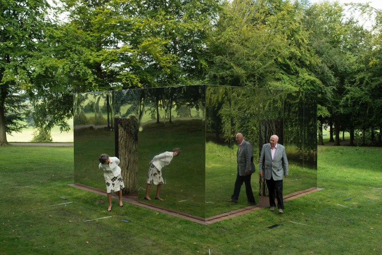 Peregrine 'Stoker' Cavendish (right), Duke of Devonshire, and his wife Amanda, Duchess of Devonshire examine a sculpture by Spanish artist Cristina Iglesias entitled 'Habitacion Vegetal XV' that features in the 'Beyond Limits' exhibition in the grounds of Chatsworth House near Bakewell, northern England, on September 9, 2016. (OLI SCARFF/AFP/Getty Images)