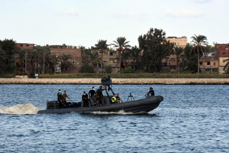 Egyptian medics arrive on a boat carrying bodies of migrants, during a search operation after a boat carrying migrants capsized in the Mediterranean, along the shore in the Egyptian port city of Rosetta on September 21, 2016. A boat carrying up to 450 migrants capsized in the Mediterranean off Egypt's north coast, drowning 42 people and prompting a search operation that rescued 163 passengers, officials said. (Mohamed El-Shahed/AFP/Getty Images)