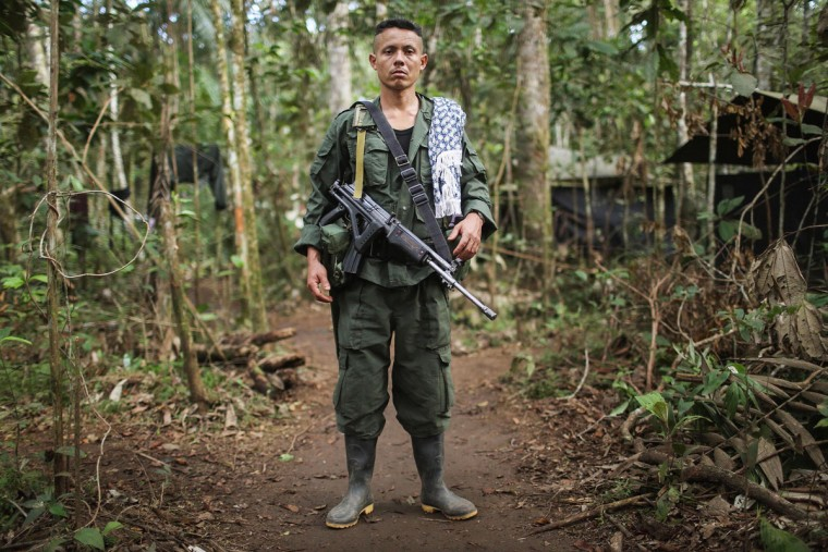 FARC rebel Wilson poses at the 10th Guerrilla Conference in the remote Yari plains where the peace accord was in the process of being ratified by the FARC on September 23, 2016 in El Diamante, Colombia. The peace agreement, which was ratified tody by the FARC, attempts to end the 52-year-old guerrilla war between the FARC and the state, the longest-running armed conflict in the Americas which left 220,000 dead. The final agreement is set to be signed on September 26 and will then be put to vote by the public in a referendum on October 2. The plan calls for a disarmament and re-integration of most of the estimated 7,000 FARC fighters. (Photo by Mario Tama/Getty Images)