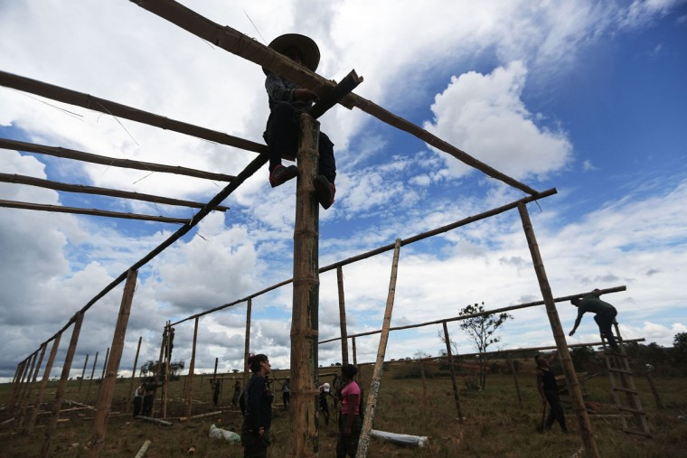 FARC (Revolutionary Armed Forces of Colombia) rebels build a temporary housing structure at the 10th Guerrilla Conference in the remote Yari plains where the peace accord was in the process of being ratified by the FARC on September 22, 2016 in El Diamante, Colombia. The peace agreement, which was ratified tody by the FARC, attempts to end the 52-year-old guerrilla war between the FARC and the state, the longest-running armed conflict in the Americas which left 220,000 dead. The final agreement is set to be signed on September 26 and will then be put to vote by the public in a referendum on October 2. The plan calls for a disarmament and re-integration of most of the estimated 7,000 FARC fighters. (Photo by Mario Tama/Getty Images)