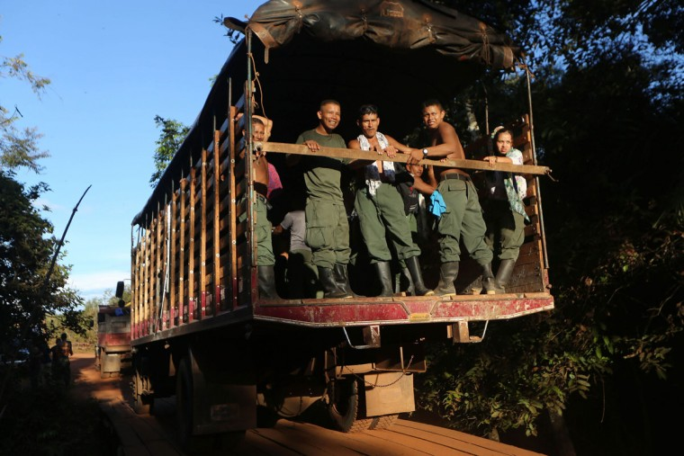 FARC rebels ride on a truck at the 10th Guerrilla Conference in the remote Yari plains where the peace accord was in the process of being ratified by the FARC on September 22, 2016 in El Diamante, Colombia. The peace agreement, which was ratified tody by the FARC, attempts to end the 52-year-old guerrilla war between the FARC and the state, the longest-running armed conflict in the Americas which left 220,000 dead. The final agreement is set to be signed on September 26 and will then be put to vote by the public in a referendum on October 2. The plan calls for a disarmament and re-integration of most of the estimated 7,000 FARC fighters. (Photo by Mario Tama/Getty Images)