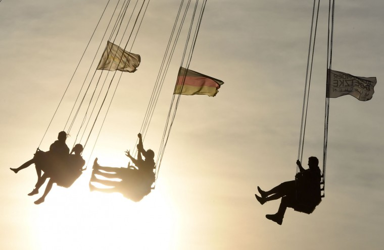 People ride the chair swing at the Theresienwiese Oktoberfest fair grounds in Munich, southern Germany, on September 22, 2016. Oktoberfest, the world's biggest beer festival, runs until October 3, 2016. (Christof Stache/AFP/Getty Images)