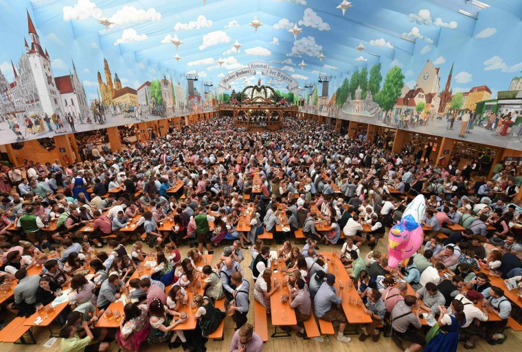 Visitors sit in a festival tent of the Oktoberfest beer festival at the Theresienwiese in Munich, southern Germany, on September 22, 2016. Oktoberfest, the world's biggest beer festival, runs until October 3, 2016. (Christof Stache/AFP/Getty Images)