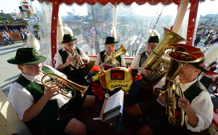 Musicians dressed in traditional Bavarian clothes perform at the Theresienwiese Oktoberfest fair grounds in Munich, southern Germany, on September 22, 2016. Oktoberfest, the world's biggest beer festival, runs until October 3, 2016. (Christof Stache/AFP/Getty Images)
