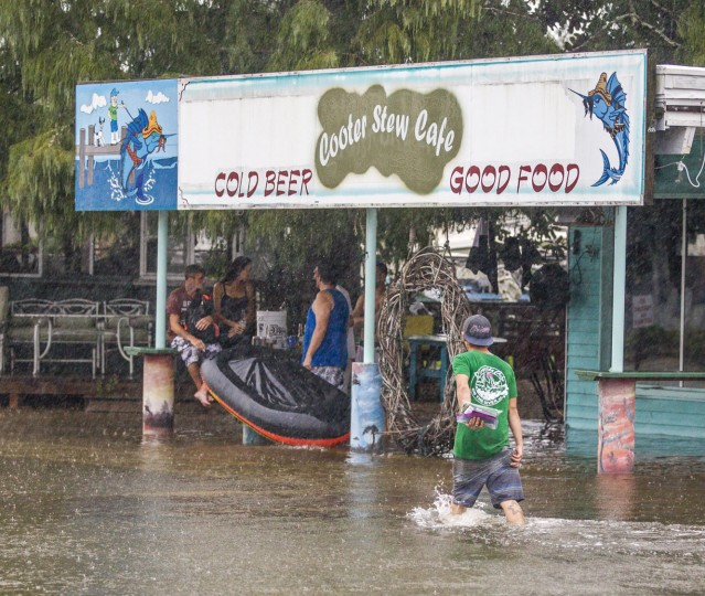 People take shelter under a canopy of a cafe flooded from the storm surge from Hurricane Hermaine on September 1, 2016 in Saint Marks, Florida. Hurricane warnings have been issued for parts of Florida's Gulf Coast as Hermine is expected to make landfall as a Category 1 hurricane (Photo by Mark Wallheiser/Getty Images)