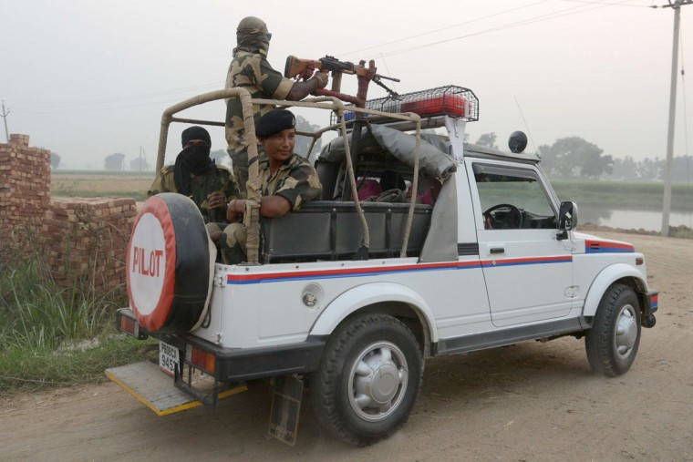 Indian Border Security Force (BSF) personnel patrol at the India-Pakistan border village Daoke, about 40 kms from Amritsar on September 30, 2016. India evacuated thousands of people living near the border with Pakistan on September 30, a day after carrying out strikes along the de-facto frontier in disputed Kashmir that have dramatically escalated tensions between the nuclear-armed neighbours. / (AFP Photo/Narinder Nanu)