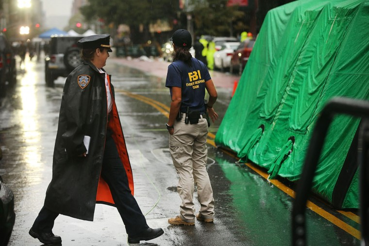 Police and FBI members continue to search the area around the scene of a bombing in the Chelsea neighborhood of Manhattan last Saturday night on September 19, 2016 in New York City. Ahmad Khan Rahami, the man believed to be responsible for the explosion in Manhattan on Saturday night and an earlier bombing in New Jersey was taken into custody on Monday afternoon following a gunfight where he was wounded by police in Linden, New Jersey. (Photo by Spencer Platt/Getty Images)
