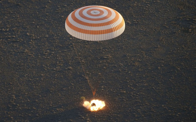 A landing module of the Russian Soyuz TMA-19M space craft carrying crew members of the International Space Station (ISS), Russian cosmonauts Alexey Ovchinin, Oleg Skripochka and US NASA astronaut Jeffrey Williams, lands some 150 kms to the east of the city of Dzhezkazgan in Kazakhstan on September 7, 2016. The ISS space laboratory has been orbiting Earth at about 28,000 kilometres per hour (17,400 miles per hour) since 1998. (AFP PHOTO / POOL / MAXIM SHIPENKOV)
