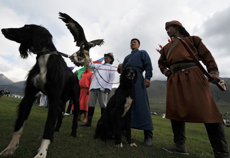 Berkutchi (eagle hunters) hold their birds, golden eagles, during the World Nomad Games 2016 in the Kyrchin (Semenovskoe) gorge, some 300 km from Bishkek on September 5, 2016. (VYACHESLAV OSELEDKO/AFP/Getty Images)