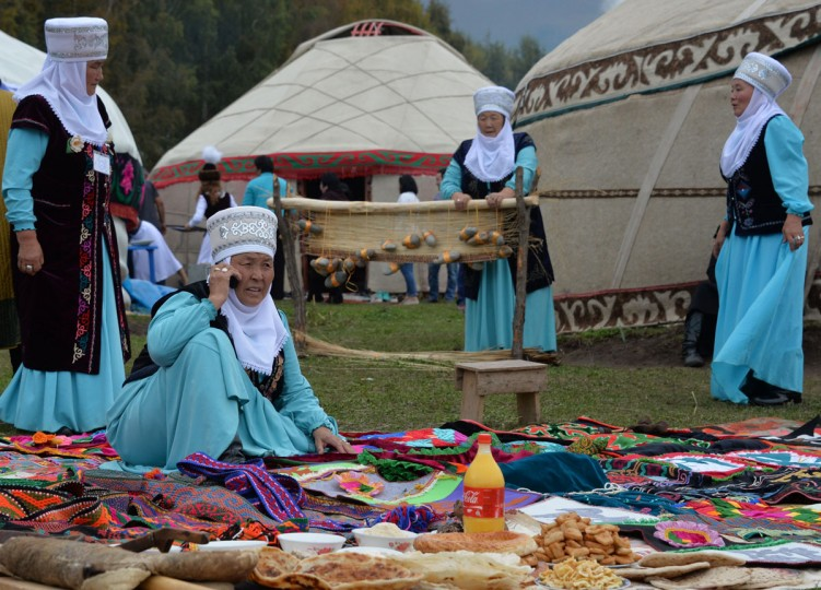 Kyrgyz women present traditional crafts, clothes and food in front of yurtas (nomad's tents) during the World Nomad Games 2016 in the Kyrchin (Semenovskoe) gorge, some 300 kms outside the capital Bishkek, on September 4, 2016. (VYACHESLAV OSELEDKO/AFP/Getty Images)