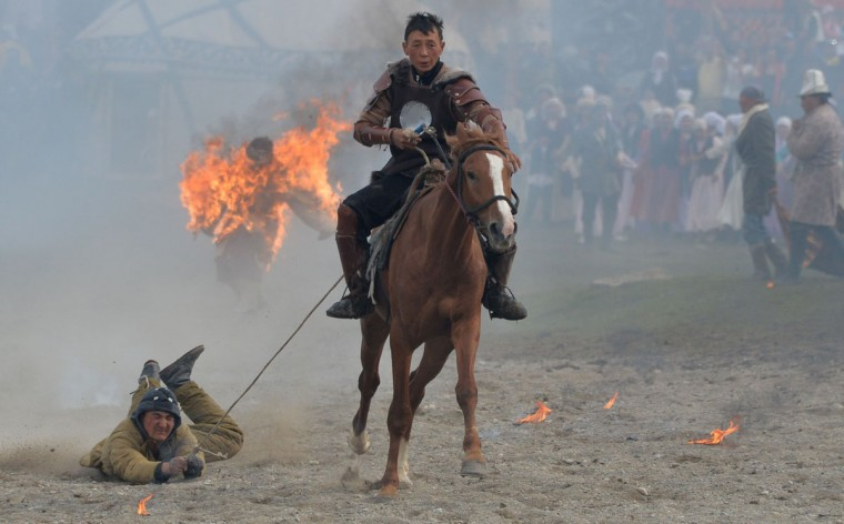 Kyrgyz stuntmen perform during the World Nomad Games 2016 in the Kyrchin (Semenovskoe) gorge, some 300 kms outside the capital Bishkek, on September 4, 2016. (VYACHESLAV OSELEDKO/AFP/Getty Images)