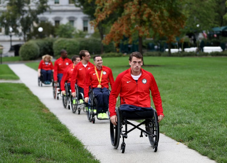 WASHINGTON, DC - SEPTEMBER 29: Members of the Paralympic team head to East Room of the White House on September 29, 2016 in Washington, DC. President Obama and First Lady Michelle Obama honored U.S. Olympic and Paralympic athletes for their participation and success in this years Games in Rio. (Photo by Elsa/Getty Images)
