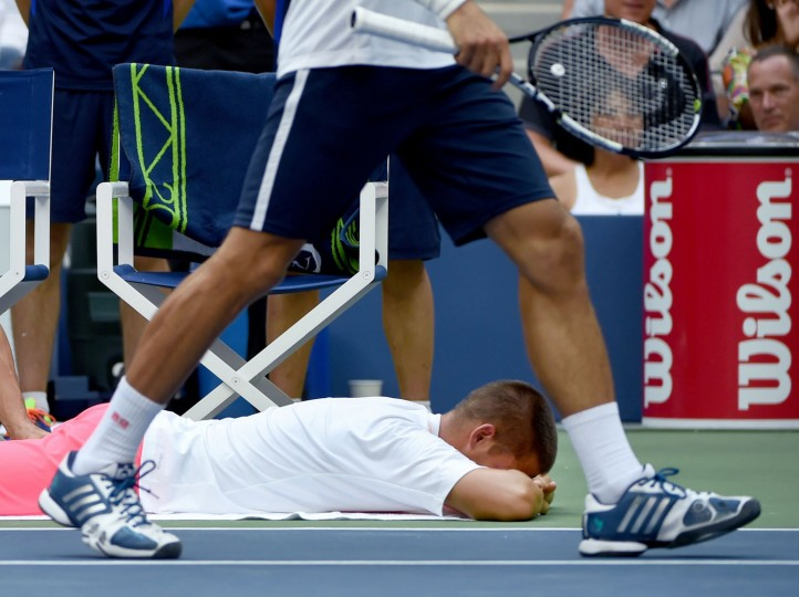 Mikhail Youzhny of Russia gets a medical time out to be worked on by a trainer during his match against Novak Djokovic of Serbia at the US Open 2016 at the USTA Billie Jean King National Tennis Center in New York on September 2, 2016. (Timothy A. Clary/AFP/Getty Images)