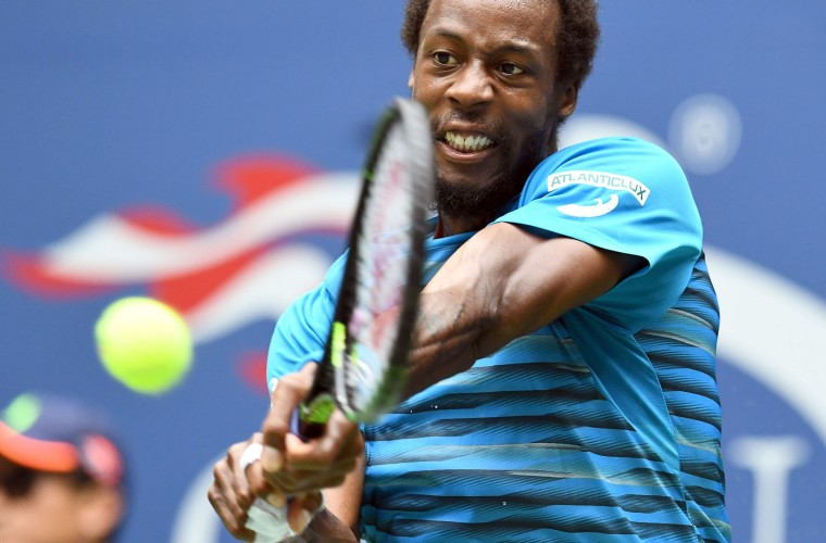 Gael Monfils of France hits a return against his compatriot Lucas Pouille during their 2016 US Open Mens Singles quarterfinal match at the USTA Billie Jean King National Tennis Center in New York on September 6, 2016. (Jewel Samad/AFP/Getty Images)