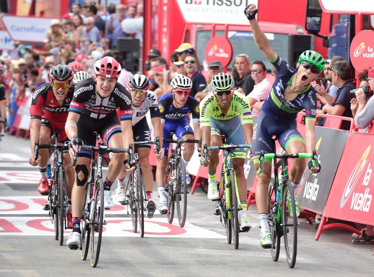 "Orica Bikeexchange's Danish cyclist Magnus Cort Nielsen (R) celebrates winning as he crosses the finish line during the 18th stage of the 71st edition of ""La Vuelta"" Tour of Spain, a 191km route from Requena to Gandia, on September 8, 2016. (Jose Jordan/AFP/Getty Images)"