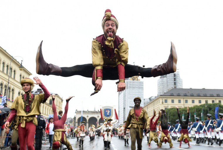 Acrobats perform during the costume parade at the Oktoberfest beer festival in Munich, southern Germany, on September 18, 2016, one day after it's opening. The World's largest beer festival Oktoberfest will run until October 3, 2016. (Christof Stache/AFP/Getty Images)