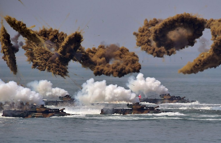 """South Korean amphibious vehicles fire smoke shells during a re-enactment of the Incheon landing to mark the 66th anniversary of the start of Operation Chromite, the battle that turned the tide in the Korean War, in the western port city of Incheon on September 9, 2016. South Korea marked the 66th anniversary of the daring Incheon Landing which was led by US General Douglas MacArthur and led two weeks later to the recapture of Seoul from North Korean invaders during the Korean War. North Korea has conducted a fifth nuclear test, its most powerful to date, South Korea's President Park Geun-Hye said on September 9, condemning the move as an act of """"self-destruction"""" that would deepen its isolation. / (AFP Photo/Jung Yeon-je)"""