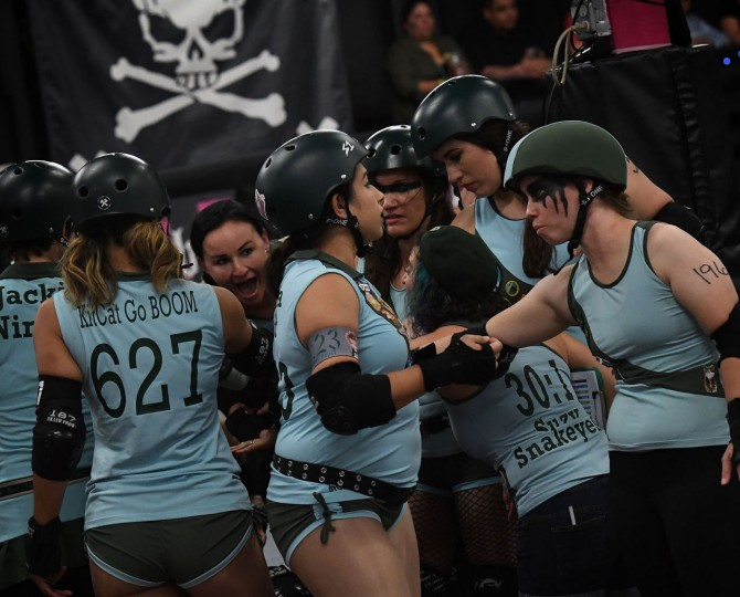 Members of the Tough Cookies team prepare to compete against the Varsity Brawlers team during the L.A. Derby Dolls women's banked track roller derby event in Los Angeles, California on September 24, 2016. Roller Derby is a contact sport that originated in America and is based on two teams formation roller skating around an oval track, with points scored as one player known as a jammer laps members of the opposing team. The sport, which began in 1922, is played predominantly by women skaters with a strong emphasis on punk aesthetics, unique costumes and humorous stage names. (Mark Ralston/AFP/Getty Images)