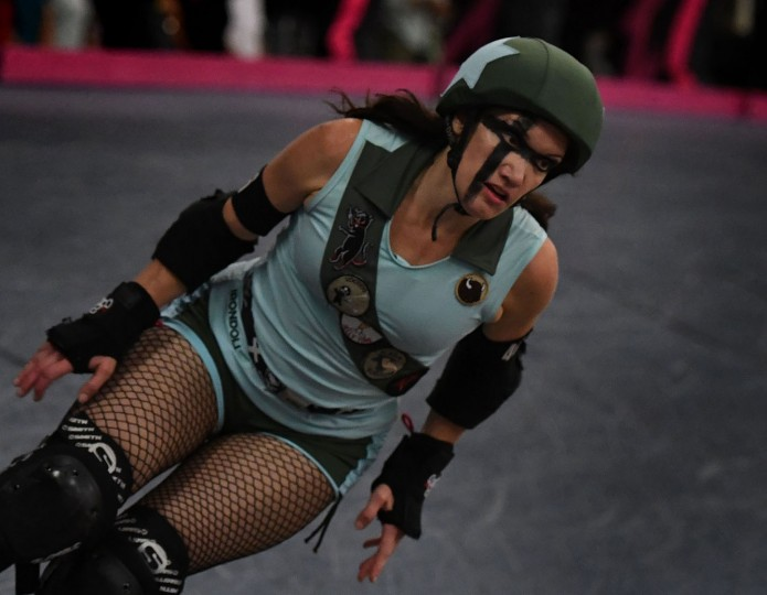 A member of the Tough Cookies team skates as she competes against the Varsity Brawlers team during the L.A. Derby Dolls women's banked track roller derby event in Los Angeles, California on September 24, 2016. Roller Derby is a contact sport that originated in America and is based on two teams formation roller skating around an oval track, with points scored as one player known as a jammer laps members of the opposing team. The sport, which began in 1922, is played predominantly by women skaters with a strong emphasis on punk aesthetics, unique costumes and humorous stage names. (Mark Ralston/AFP/Getty Images)