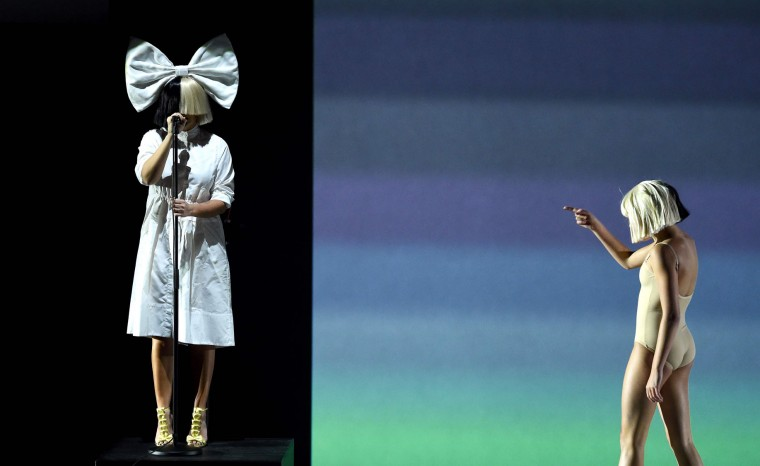 Singer Sia (L) and dancer Maddy Ziegler (R) perform on stage during an Apple event at Bill Graham Civic Auditorium in San Francisco, California on September 07, 2016. (Josh Edelson/AFP/Getty Images)