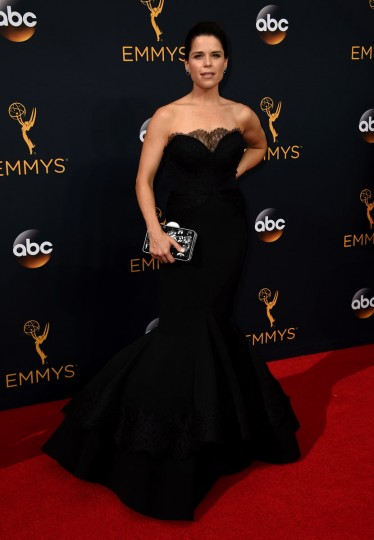 Neve Campbell arrives at the 68th Primetime Emmy Awards on Sunday, Sept. 18, 2016, at the Microsoft Theater in Los Angeles. (Photo by Jordan Strauss/Invision/AP)