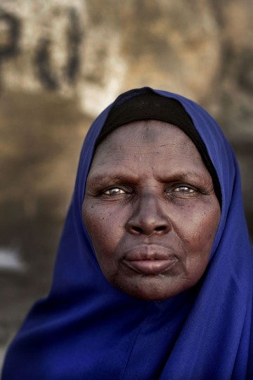 In this Sunday, Sept. 11, 2016 photo, 60-year old Mariam Abdel Karim from Sudan poses for a photograph as she prays on a rocky hill known as the Mountain of Mercy, on the Plain of Arafat, during the annual hajj pilgrimage, near the holy city of Mecca, Saudi Arabia. Karim walked from Madina to Mecca to Arafat and will complete her pilgrimage by walking. (AP Photo/Nariman El-Mofty)