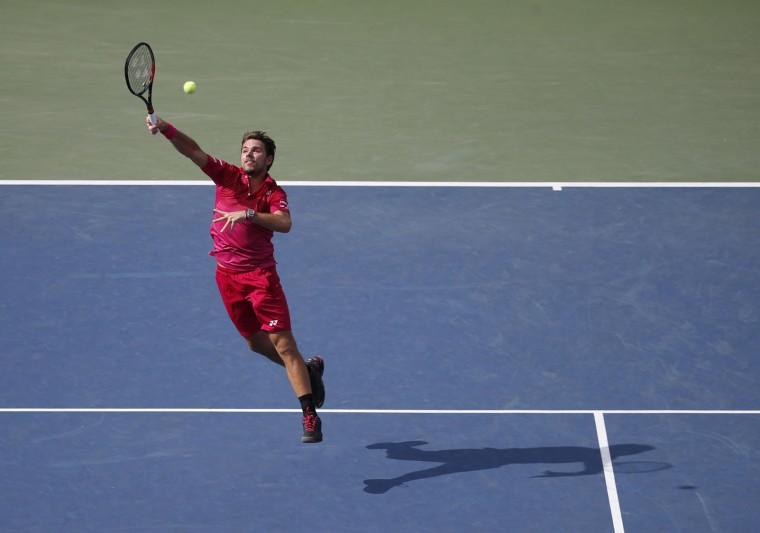 Stan Wawrinka, of Switzerland, returns a shot to Illya Marchenko, of Ukraine, during the fourth round of the U.S. Open tennis tournament, Monday, Sept. 5, 2016, in New York. (AP Photo/Jason DeCrow)