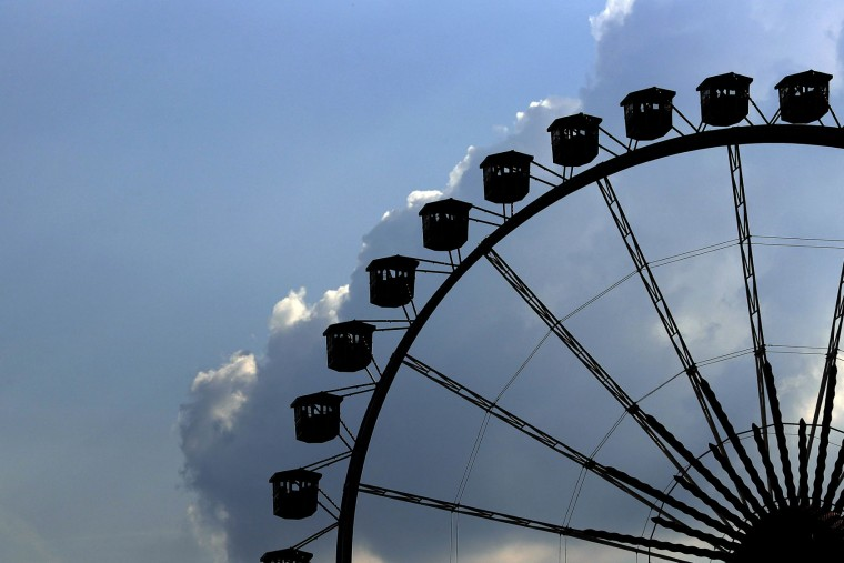 People ride the Ferris wheel at the 183rd Oktoberfest beer festival in Munich, Germany, Monday, Sept. 26, 2016. The world's largest beer festival will be held from Sept. 17 to Oct. 3, 2016. (AP Photo/Matthias Schrader)