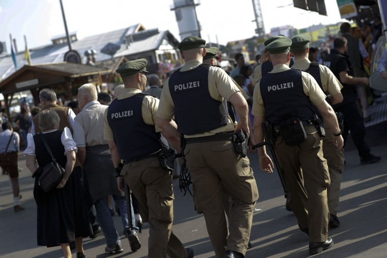 Police officers patrol at the 183rd Oktoberfest beer festival in Munich, Germany, Monday, Sept. 26, 2016. The world's largest beer festival will be held from Sept. 17 to Oct. 3, 2016. (AP Photo/Matthias Schrader)