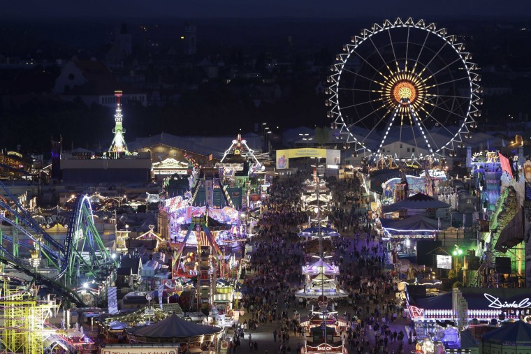 People enjoy the evening at the 183rd Oktoberfest beer festival in Munich, Germany, Monday, Sept. 26, 2016. The world's largest beer festival will be held from Sept. 17 to Oct. 3, 2016. (AP Photo/Matthias Schrader)