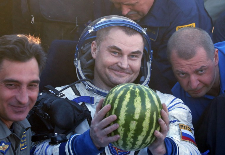 Member of the International Space Station (ISS) crew Russian cosmonauts Alexey Ovchinin, center, poses for a photo shortly after landing near the town of Zhezkazgan, Kazakhstan, Wednesday, Sept. 7, 2016. A record-setting American and two Russians landed safely back on Earth Wednesday after a six-month mission aboard the International Space Station. (Maxim Shipenkov/Pool Photo via AP)