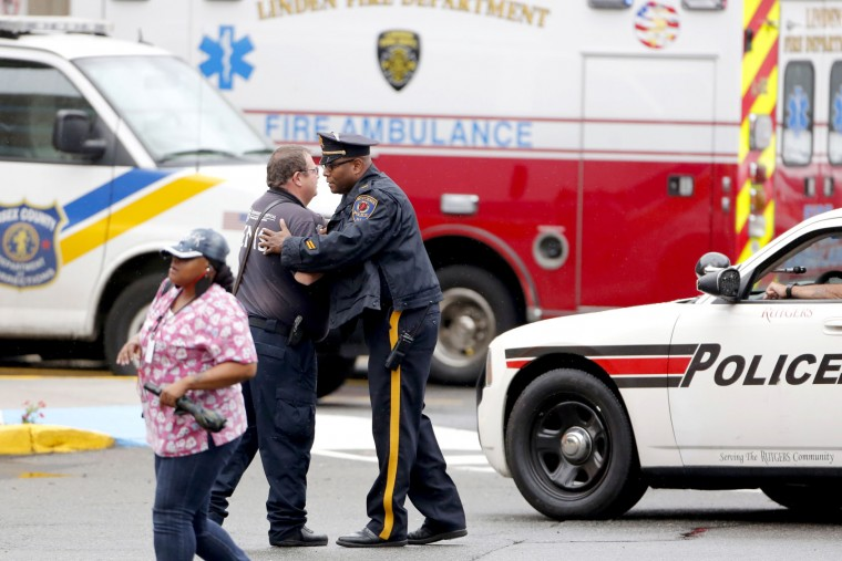 Law enforcement gather outside the emergency room of University Hospital after a shoot out in Linden where officers and terror suspect was Ahmad Khan Rahami were wounded and Rahami was apprehended Monday, Sept. 19, 2016. Newark, NJ, USA (Aristide Economopoulos | NJ Advance Media via AP)