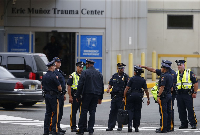 Police and investigators gather outside University Hospital in Newark, N.J. Monday, Sep. 19, 2016. Ahmad Khan Rahami, 28 was taken into custody and transported to the hospital after a shootout that also wounded two Linden police officers. Rahami was sought in connection with the bombing in the Chelsea section of Manhattan on Saturday night. (AP Photo/Rich Schultz)