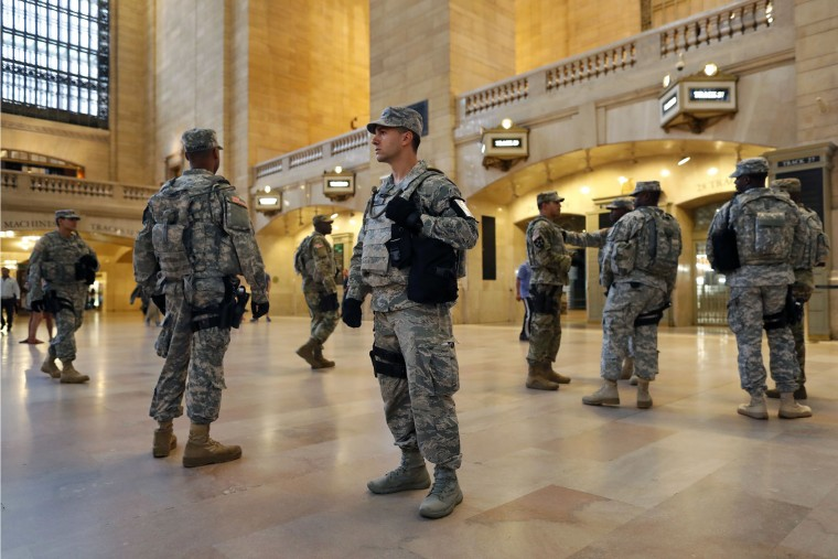 Members of the U.S. Armed Forces stand guard in Grand Central Terminal, Sunday, Sept. 18, 2016, in New York. Gov. Andrew Cuomo said about 1,000 additional law enforcement officers were being deployed after the Saturday night blast in Chelsea, a primarily residential neighborhood on Manhattan's west side. (AP Photo/Mary Altaffer)