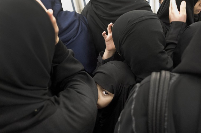 In this Thursday, Sept. 15, 2016 photo, a Saudi girl gets caught in the crowd of women visiting Al-Masjid an-Nabawi or Prophet Muhammad's Mosque, which situates Muhammad's tomb, as she looks for her mother, in Medina, Saudi Arabia. During the hajj, women wear the hijab, a scarf to cover their hair in deference to God. Some decide to return home and continue covering their hair in respect. But for others, their faith isn't tied to the scarf. (AP Photo/Nariman El-Mofty)