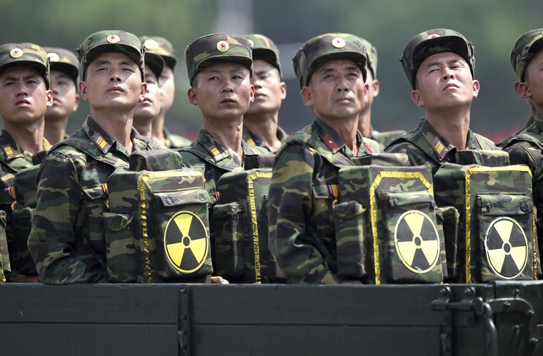 FILE - In this July 27, 2013, file photo, North Korean soldiers turn and look towards their leader Kim Jong Un from a military parade vehicle as they carry packs marked with the nuclear symbol during a ceremony marking the 60th anniversary of the Korean War armistice in Pyongyang, North Korea. Mark up another first for North Korea - two nuclear tests in one year. With few other options, or allies to rally behind it, this is how Pyongyang likes to play its cards in the power game that is northeast Asian politics. The question is whether it can play them well enough to get what it really wants: international recognition, security guarantees and, at the most fundamental level, its own continued survival. (AP Photo/Wong Maye-E, File)