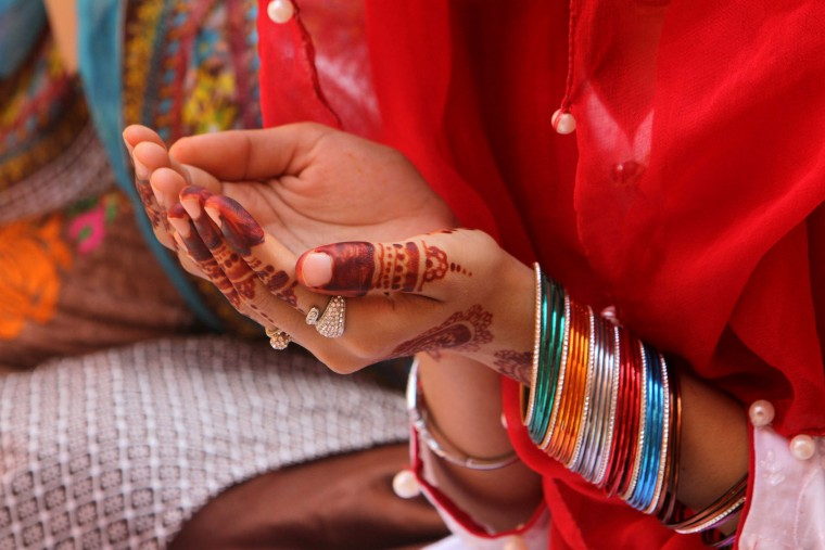 A Pakistani Muslim with hands decorated with henna, offers Eid al Adha prayers at the Badshahi mosque in Lahore, Pakistan, Tuesday, Sept. 13, 2016. Pakistanis Muslims are celebrating the Eid al-Adha, or the Feast of the Sacrifice, on Tuesday to mark the willingness of the Prophet Ibrahim -- Abraham to Christians and Jews -- to sacrifice his son. During the holiday Muslims slaughter sheep and cattle, distribute part of the meat to the poor and eat the rest. (AP Photo/K.M. Chaudary)